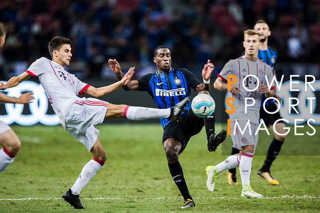Bayern Munich Forward Milos Pantovic (L) trips up with FC Internazionale Midfielder Geoffrey Kondogbia (C) during the International Champions Cup match between FC Bayern and FC Internazionale at National Stadium on July 27, 2017 in Singapore. Photo by Marcio Rodrigo Machado / Power Sport Images