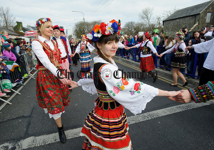 Members of the Irish Polish community in their traditional dress during the St Patrick's Day parade in Ennis. Photograph by John Kelly.