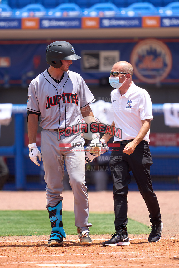 Jupiter Hammerheads trainer Sandy Krum checks on batter Cameron Barstad (17) during a game against the St. Lucie Mets on May 5, 2021 at Clover Park in St. Lucie, Florida.  (Mike Janes/Four Seam Images)