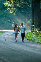 Young couple walking down the road holding hands