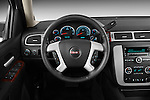 Steering wheel view of a 2012 GMC Yukon SLE