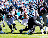 CHARLOTTE, NC - NOVEMBER 17: Keith Smith #40 of the Atlanta Falcons looks for a hole during a running play during a game between Atlanta Falcons and Carolina Panthers at Bank of America Stadium on November 17, 2019 in Charlotte, North Carolina.