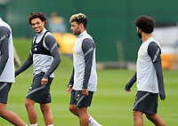 14th September 2021: The  AXA Training Centre, Kirkby, Knowsley, Merseyside, England: Liverpool FC training ahead of Champions League game versus AC Milan on 15th September: Trent Alexander-Arnold of Liverpool chats with team mates Alex Oxlade-Chamberlain and Mohammed Salah