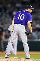 Louisville Bats relief pitcher Ryan Dennick (10) looks to his catcher for the sign against the Charlotte Knights at BB&T Ballpark on June 26, 2014 in Charlotte, North Carolina.  The Bats defeated the Knights 6-4.  (Brian Westerholt/Four Seam Images)