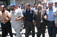 "Supporters of the Hamas movement of trade unions in solidarity with Prime Minister Ismail Haniya, the article denounced the decisions of Palestinian President Mahmoud Abbas to separate the West Bank from the Gaza Strip, June 24, 2007 .""photo by Fady Adwan"""