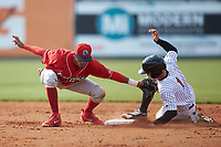 Tyler Frost (1) of the Kannapolis Intimidators slides into second base ahead of the tag from Lakewood BlueClaws second baseman Daniel Brito (21) at Kannapolis Intimidators Stadium on April 8, 2018 in Kannapolis, North Carolina.  The Intimidators defeated the BlueClaws 4-3 in game two of a double-header.  (Brian Westerholt/Four Seam Images)