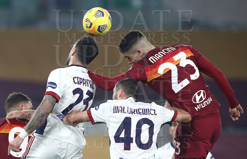 Football, Serie A: AS Roma - Cagliari calcio, Olympic stadium, Rome, December 23, 2020. <br /> Roma's Gianluca Mancini (r) in action with Cagliari's Luca Ceppitelli (r) during the Italian Serie A football match between Roma and Cagliari at Rome's Olympic stadium, on December 23, 2020.  <br /> UPDATE IMAGES PRESS/Isabella Bonotto