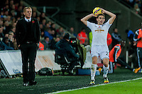 Sunday 9th November 2014<br /> Pictured: Angel Rangel of Swansea City throws the ball in as Garry Monk, Manager of Swansea City looks on<br /> Re: Barclays Premier League Swansea City v Arsenal at the Liberty Stadium, Swansea, Wales,UK