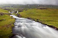 Vestdalsa River cascading through canyon over Vestdalsfossar Falls, East Iceland, Iceland