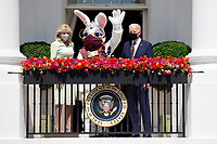 US President Joe Biden (R) and First Lady Jill Biden (L) stand with the Easter bunny (C) after President Biden delivered remarks regarding Easter, on the Truman Balcony at the South Lawn of the White House, in Washington, DC, USA, 05 April 2021. The traditional Easter Egg Roll at the White House with thousands of visitors was not held due to the coronavirus COVID-19 pandemic.<br /> CAP/MPI/RS<br /> ©RS/MPI/Capital Pictures