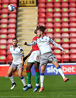 10th October 2020; Bescot Stadium, Walsall, West Midlands, England; English Football League Two, Walsall FC versus Colchester United; Ben Stevenson of Colchester United  challenges for the aerial ball with Elijah Debayo of Walsall