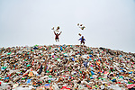 Boys live and play atop mountain of rubbish by Sohel Parvez Haque
