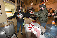 CHLLY-DAY CHILI<br />Tami King with Pig Trail Harley-Davidson in Rogers serves chili on Saturday Feb. 13, 2021 to Lynn Peterson after a seminar at the dealership. The seminar taught riders about motorcycle tires and how to maintain them. Go to nwaonline.com/210214Dailly/ to see more photos.<br />(NWA Democrat-Gazette/Flip Putthoff)