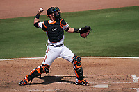 Baltimore Orioles catcher Chance Sisco (15) throws down to second base during a Major League Spring Training game against the Philadelphia Phillies on March 12, 2021 at the Ed Smith Stadium in Sarasota, Florida.  (Mike Janes/Four Seam Images)