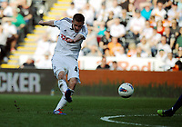 FAO SPORTS PICTURE DESK<br /> Pictured: Gylfi Sigurdsson of Swansea shoots the ball off target towards the last minutes of the game. Saturday, 24 March 2012<br /> Re: Premier League football, Swansea City FC v Everton at the Liberty Stadium, south Wales.