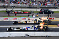 Aug. 19, 2011; Brainerd, MN, USA: NHRA top fuel dragster driver Antron Brown (near) races alongside Tony Schumacher during qualifying for the Lucas Oil Nationals at Brainerd International Raceway. Mandatory Credit: Mark J. Rebilas-