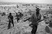 Andjadja, Eastern Tchad, June 2, 2004.Villagers have organized themselves into an militia to defend their land and villages against Djanjavid incursions.The large 'wadi' in the backgroung marks the border with Sudan.