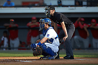 Burlington Royals catcher Chris Hudgins (27) on defense as home plate umpire Nathan Dietrich looks on during the game against the Johnson City Cardinals at Burlington Athletic Stadium on July 15, 2018 in Burlington, North Carolina. The Cardinals defeated the Royals 7-6.  (Brian Westerholt/Four Seam Images)