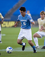North Carolina midfielder Michael Callahan (5) dribbles the ball.  North Carolina Tar Heels defeated Wake Forest Demon Deacons 1-0 in the semifinal match of the NCAA Men's College Cup at Pizza Hut Park in Frisco, TX on December 12, 2008.  Photo by Wendy Larsen/isiphotos.com