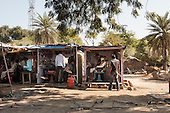 Rajasthan, India. Between Jaipur and Ranthambore. Barbers' kiosks at the roadside.