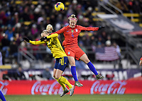 COLUMBUS, OH - NOVEMBER 07: Caroline Seger #17 of Sweden and Becky Sauerbrunn #4 of the USA battle in the air for a ball during a game between Sweden and USWNT at MAPFRE Stadium on November 07, 2019 in Columbus, Ohio.