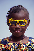 Niamey, Niger.  Nigerien Girl in Mickey Mouse Sunglasses.