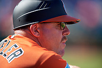 Baltimore Orioles first base coach Arnie Beyeler (13) in the dugout during a Grapefruit League Spring Training game against the Philadelphia Phillies on February 28, 2019 at Spectrum Field in Clearwater, Florida.  Orioles tied the Phillies 5-5.  (Mike Janes/Four Seam Images)