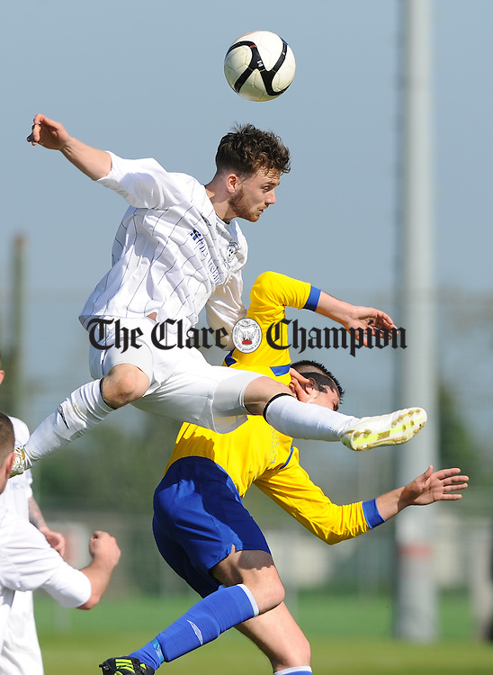 John Meleady of AUL Dublin in action against Darren Murphy of Clare League during the Oscar Traynor Trophy Final at AUL Complex, Clonshaugh, Dublin. Photograph by John Kelly.