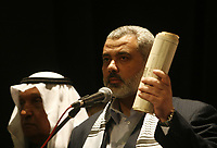 """Palestinian Prime Minister of the Hamas government in Gaza, Ismail Haniyeh, participate in a parliament meeting discussing Palestinian rights in light of the upcoming U.S.-hosted Annapolis summit, in Gaza City, Monday, Nov. 26, 2007. The Islamic Hamas rulers of Gaza stepped up their verbal attacks on Palestinian President Mahmoud Abbas on Monday ahead of a U.S.-hosted Mideast conference, saying his policies had failed and undermined prospects for Palestinian statehood and unity.""""photo by Fady Adwan"""""""