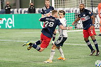 FOXBOROUGH, MA - OCTOBER 19: Alexander Buttner #28 of New England Revolution collides with Brenden Aaronson #22 of Philadelphia Union near the Revolution goal during a game between Philadelphia Union and New England Revolution at Gillette on October 19, 2020 in Foxborough, Massachusetts.