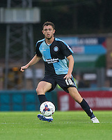 Danny Rowe of Wycombe Wanderers makes a pass during the Capital One Cup match between Wycombe Wanderers and Fulham at Adams Park, High Wycombe, England on 11 August 2015. Photo by Andy Rowland.