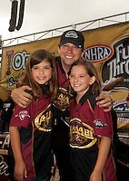 May 1, 2011; Baytown, TX, USA: NHRA top fuel dragster driver Del Worsham celebrates with his daughters after winning the Spring Nationals at Royal Purple Raceway. Mandatory Credit: Mark J. Rebilas-