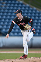 Pitcher Danny Westbury (31) of the North Greenville Crusaders delivers a pitch in a game against the Queens University Royals on Tuesday, March 12, 2019, at Fluor Field at the West End in Greenville, South Carolina. North Greenville won, 14-3. (Tom Priddy/Four Seam Images)