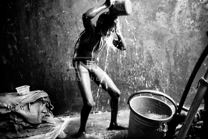 """A Bangladeshi child worker Alim,11, takes his bath inside of a tannery at Hazaribagh area, in Dhaka, Bangladesh.   In 2013, the Zurich-based Green Cross Switzerland and the New York-based Blacksmith Institute published a report on the most polluted places in the world. The report """"The Top Ten Toxic Threats, Clean Up, Progress and Ongoing Challenges,"""" puts Hazaribagh at number five. Each day in Hazaribaugh, more than 5,000 gallons of hexavalent chromium is dumped into the Buriganga river."""