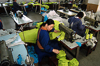 Workers sew at a textile factory in Zhengzhou, China.
