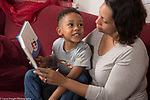 5 year old boy at home with mother, read to, looking at her and talking