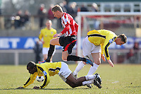 Lewis Smith of Hornchurch leaps over Carlos Talbot of Bromley - AFC Hornchurch vs Bromley - Blue Square Conference South Football at The Stadium, Upminster Bridge, Essex - 01/04/13 - MANDATORY CREDIT: Gavin Ellis/TGSPHOTO - Self billing applies where appropriate - 0845 094 6026 - contact@tgsphoto.co.uk - NO UNPAID USE.