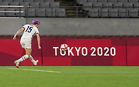 TOKYO, JAPAN - JULY 21: Megan Rapinoe #15 of the USWNT crosses during a game between Sweden and USWNT at Tokyo Stadium on July 21, 2021 in Tokyo, Japan.