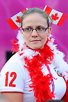 London, England 26/08/2012 - Sarah Mailhot of Swimming Canada enjoys the Paralympic Village Plaza during the flag raising ceremony at the London 2012 Paralympic Games. (Photo: Phillip MacCallum/Canadian Paralympic Committee)