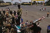 Addis Ababa, Ethiopia<br /> May 29, 1991<br /> <br /> In the city's center heavily armed Ethiopian People's Revolutionary Democratic Front (EPRDF) soldiers load into a truck to patrol the streets that still contain pockets of pro-Mengistu resistance. <br /> <br /> In late May 1991 the long civil war in Ethiopia came to a climax when the alliance of four rebel groups, the EPRDF, toppled the authoritarian government of Mengistu Haile-Mariam and took control of Addis Ababa and the nation. The governing regime declared a cease-fire and fled. <br /> <br /> In July 1991 the 24 different groups met in the capital and established a multi-party provisional government headed by Meles Zenawi, the Tigray Rebel Leader, to lead the country to its first free elections within two years.
