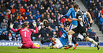 Harry Forrester slides in to scare the keeper
