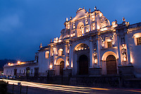 Night photo of famous Cathedral de Santiago with twilight and streaks of traffic  in the tourism town of Antigua Guatemal