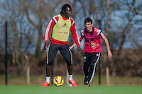 SWANSEA, WALES - FEBRUARY 17: Bafetibis Gomis of Swansea City  in action during training session at the Fairwood training ground on February 17, 2015 in Swansea, Wales.  (Photo by Athena Pictures )
