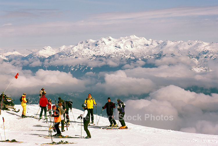 A Group of Skiers downhill skiing on Blackcomb Mountain at Whistler Resort, in the Coast Mountains, Whistler, British Columbia, Canada