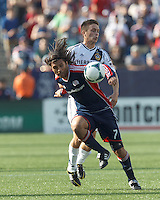 New England Revolution midfielder Juan Carlos Toja (7) and LA Galaxy midfielder Michael Stephens (26) battle for the ball. In a Major League Soccer (MLS) match, the New England Revolution (blue) defeated LA Galaxy (white), 5-0, at Gillette Stadium on June 2, 2013.