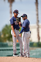 GCL Twins relief pitcher Steven Cruz (17) listens to pitching coach Richard Salazar (43) on the mound during the first game of a doubleheader against the GCL Orioles on August 1, 2018 at CenturyLink Sports Complex Fields in Fort Myers, Florida.  GCL Twins defeated GCL Orioles 7-6 in the completion of a suspended game originally started on July 31st, 2018.  (Mike Janes/Four Seam Images)