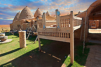 "Pictures of the beehive adobe buildings of Harran with a summer outdoor bed,  south west Anatolia, Turkey.  Harran was a major ancient city in Upper Mesopotamia whose site is near the modern village of Altınbaşak, Turkey, 24 miles (44 kilometers) southeast of Şanlıurfa. The location is in a district of Şanlıurfa Province that is also named ""Harran"". Harran is famous for its traditional 'beehive' adobe houses, constructed entirely without wood. The design of these makes them cool inside. 31"