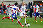 Atletico de Madrid's Juanfran (L) and Real Madrid´s Cristiano Ronaldo during quarterfinal first leg Champions League soccer match at Vicente Calderon stadium in Madrid, Spain. April 14, 2015. (ALTERPHOTOS/Victor Blanco)