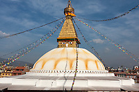 Bodhnath, Nepal.  The All-Seeing Eyes of the Buddha Gaze out from above the Stupa of Bodhnath, a center of Tibetan Buddhism, near Kathmandu.  The 13 tapering levels above the dome represent the 13 stages of perfection leading to nirvana.   The stupa survived the earthquale of April 2015.