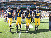 California captains' Mitchell Schwartz, Marvin Jones, D.J. Holt, and Trevor Guyton walk on the field for coin toss before the game against Utah at AT&T Park in San Francisco, California on October 22, 2011.   California defeated Utah, 34-10.